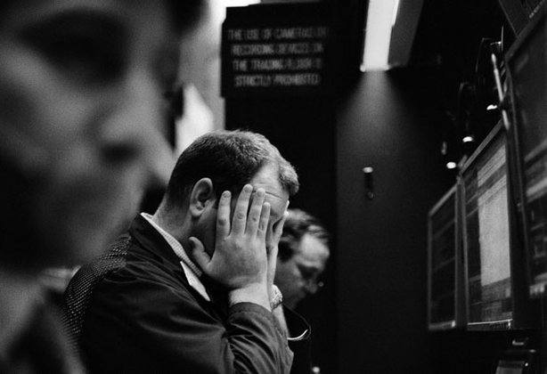A trader reacts as the market drops; New York Stock Exchange, February 2009.