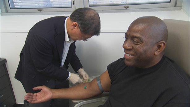 Dr. David Ho, HIV/AIDS specialist, draws blood from Magic Johnson.