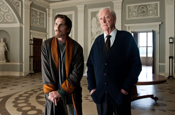 "Christian Bale and Michael Caine return as Bruce Wayne and Alfred in ""The Dark Knight Rises."""