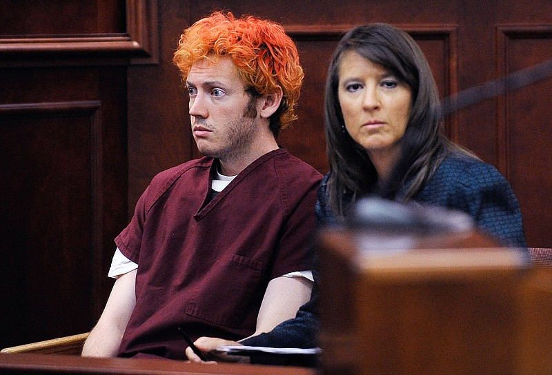 Accused movie theater shooter James Holmes (L) makes his first court appearan...