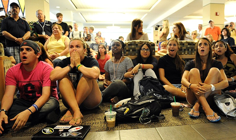 Penn State students and others react to the sanctions the NCAA announced agai...