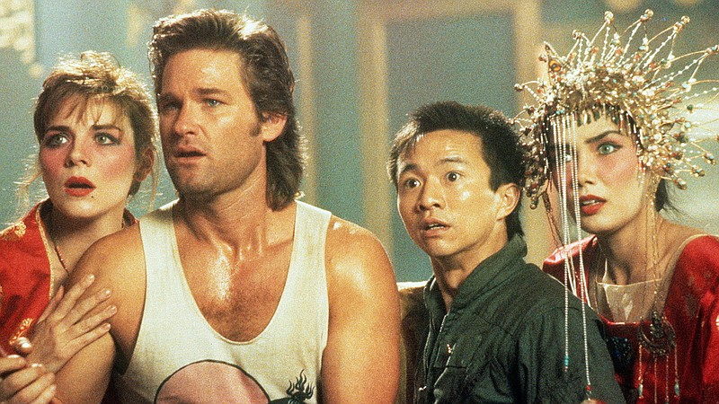 Kim Cattrall, Kurt Russell, Dennis Dun, and Suzee Pai in John Carpenter's