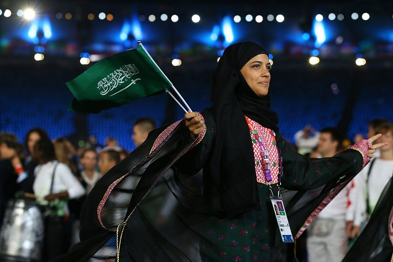 Sarah Attar of Saudi Arabia enters the stadium during the Opening Ceremony of...
