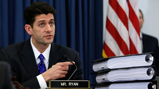 Rep. Paul Ryan, R-Wis., points to piles of the health care overhaul legislati...
