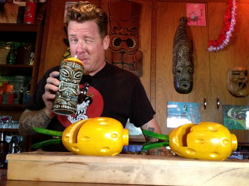 Artist Matt Reese's home bar, dubbed The Lava Flow Inn, is decked out in tiki...