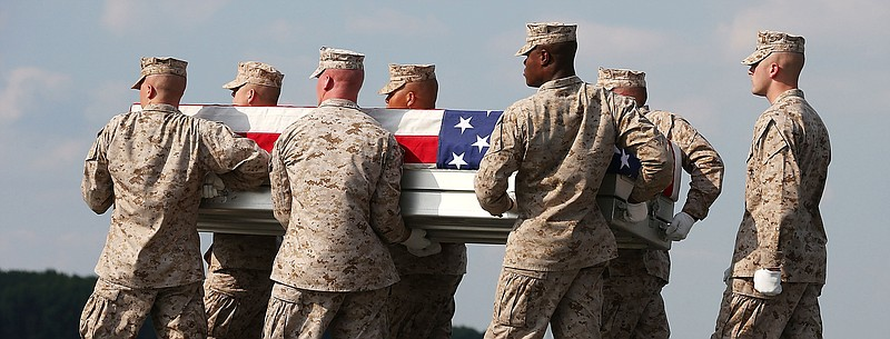 Aug. 13: At Dover Air Force Base in Delaware, the remains of Marine Lance Cpl...