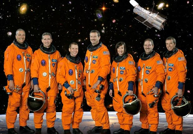 The seven astronauts of the STS-125 crew: Michael Massimino, Michael Good, Gregory Johnson, Scott Altman, Megan McArthur, John Grunsfeld and Andrew Feustel. The STS-125 mission was the final space shuttle mission to the Hubble Space Telescope.