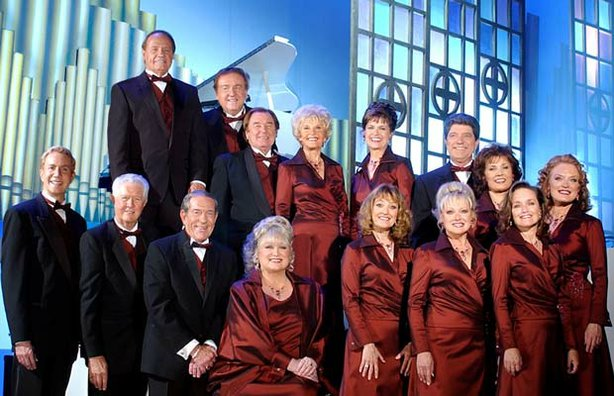 "The cast of ""Lawrence Welk Precious Memories"" gathers for an official group photo. Bottom row, left to right: Tom Netherton, Dick Dale, Jack Imel, Jo Ann Castle, Kathy Lennon, Janet Lennon, Mimi Lennon. Back row, left to right: Ken Delo, Bob Ralston, Joe Feeney, Norma Zimmer, Mary Lou Metzger, Guy Hovis, Ralna English and Gail Farrell."