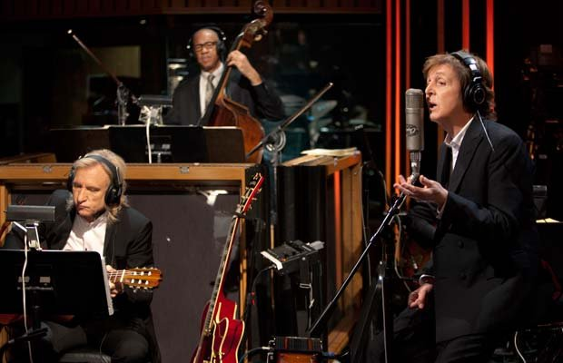 Musicians Joe Walsh, John Clayton and Paul McCartney rehearsing.