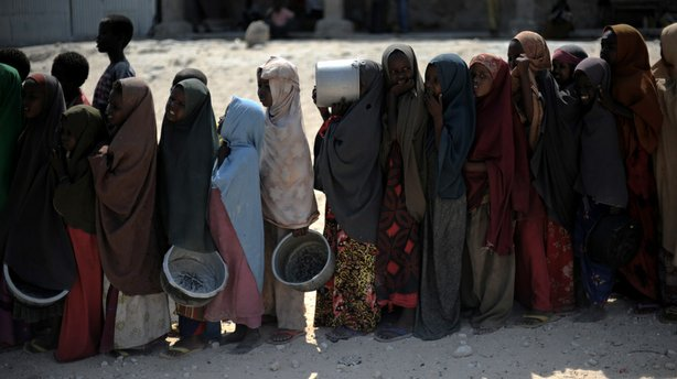 Somali girls line up to receive a hot meal in Mogadishu last year after the w...