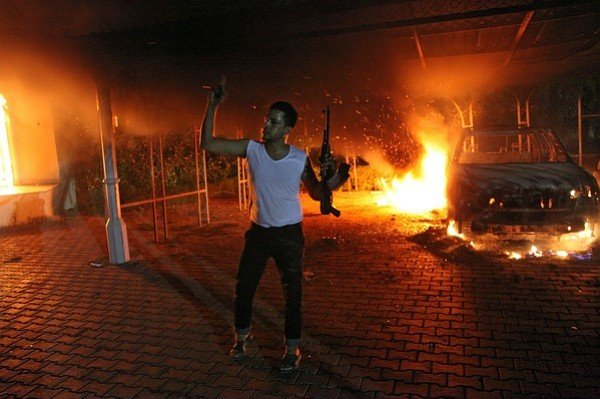 A vehicle and the surrounding area are engulfed in flames after it was set on fire inside the US consulate compound in Benghazi late on September 11, 2012.