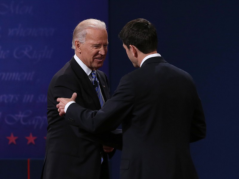 U.S. Vice President Joe Biden (L) shakes hands with Republican vice president...