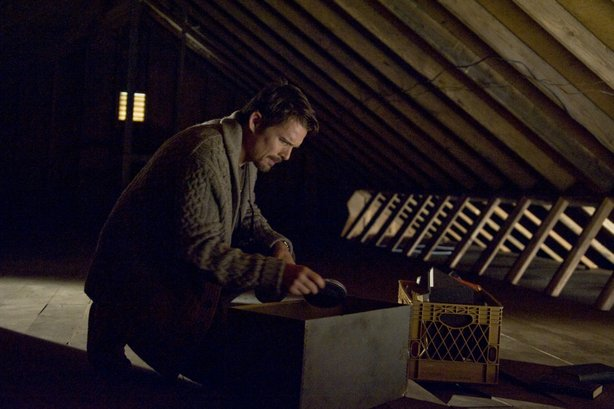 "Ethan Hawke plays a writer who discovers some disturbing home movies in the new house he's moved his family into in ""Sinister."""