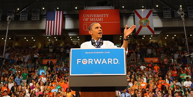 U.S. President Barack Obama speaks during a campaign rally at the BankUnited ...