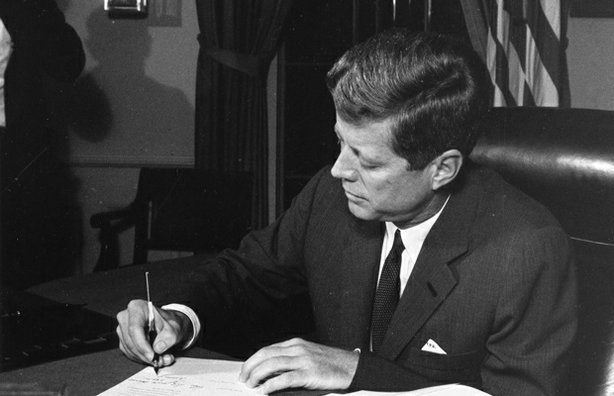 President John F. Kennedy signs the quarantine order.