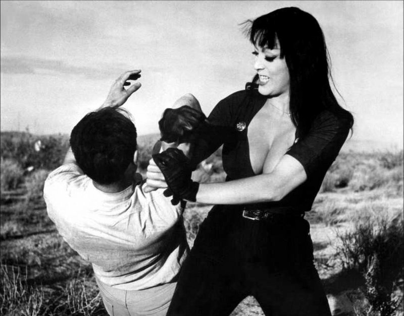 Tura Satana taking care of business in