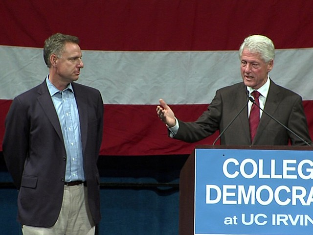 Congressional candidate Scott Peters and former President Bill Clinton at a c...