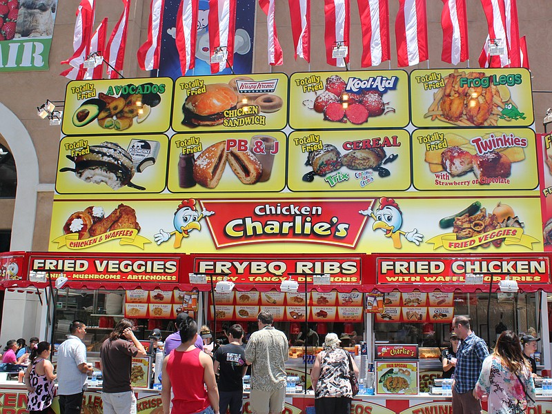 A crowd forms to feast on fried foods at the San Diego County Fair at the Del...