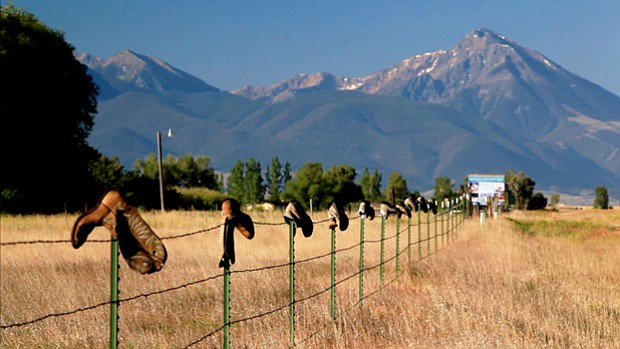 A fence lined with hanging boots in Montana. How has the Supreme Court's Citi...