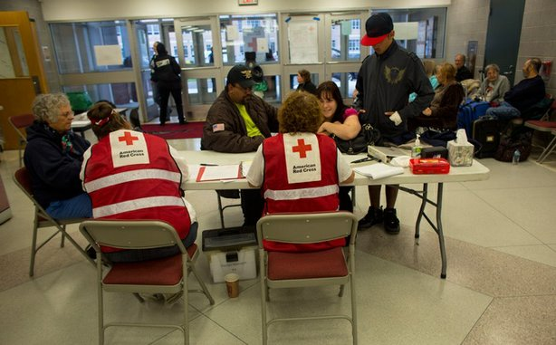 Red Cross volunteers register New Jersey residents at a shelter in Pleasantville.