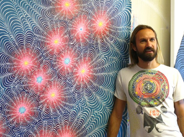 "San Diego-based artist Kelsey Brookes in his studio standing next to his painting ""Serotonin"" (2012), one of the new works on view at Quint Contemporary Art in La Jolla."