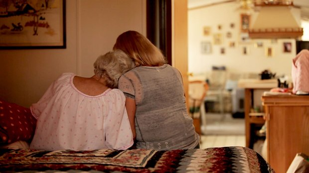 Joan Butterstein (left), terminally ill and contemplating suicide, with her d...