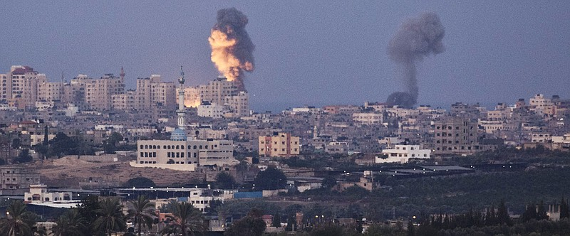 Smoke plumes rise over Gaza following Israel Air Force bombing on November 16...
