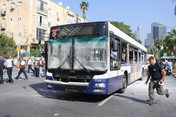 Emergency services rush to the scene of an explosion on a bus on November 21, 2012 in central Tel Aviv, Israel.