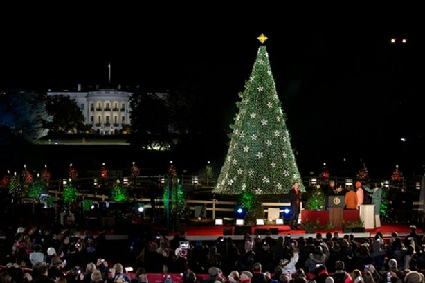 President Barack Obama, First Lady Michelle Obama, daughters Sasha and Malia, and Marian Robinson participate in the lighting of the National Christmas Tree on the Ellipse in Washington, D.C., Dec. 6, 2012.