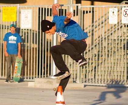 Jorge Robles shows off his skateboarding skills in front of Cherokee Point El...