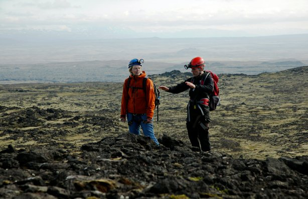Frey and Sigrun surveying the volcanic landscape, Iceland.