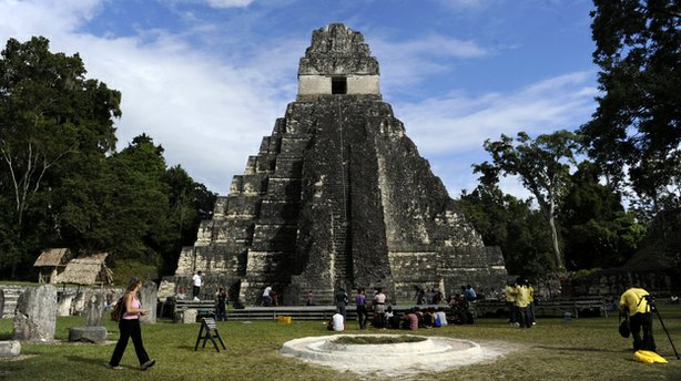 "Tourists are seen in front of the ""Gran Jaguar"" Mayan temple at the Tikal arc..."