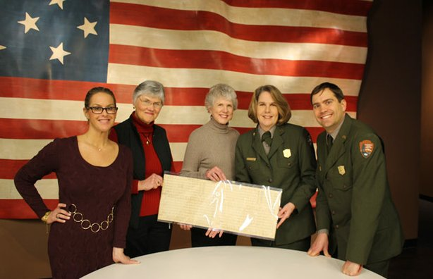 "HISTORY DETECTIVES host Elyse Luray joins Charlene Robbins and her sister Carmelle Knudsen as they turn over a cherished document from their father's collection to Curator Gregory Weidman and Chief of Interpretation Vince Vaise of the Ft. McHenry National Monument and Historic Shrine. The sheet music is the result of collaboration by John Philip Sousa and four other prominent musicians trying to draft a standard version of ""The Star-Spangled Banner."""