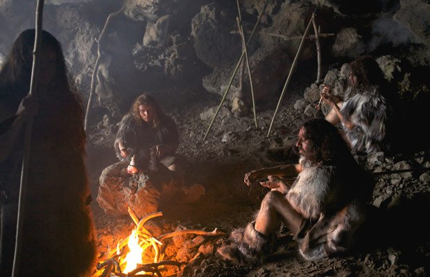 A reconstruction of Neanderthals in a cave for