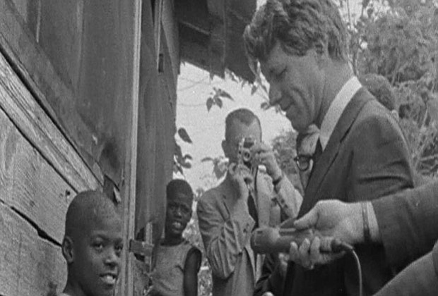 Robert F. Kennedy makes an appearance in an African-American neighborhood in ...