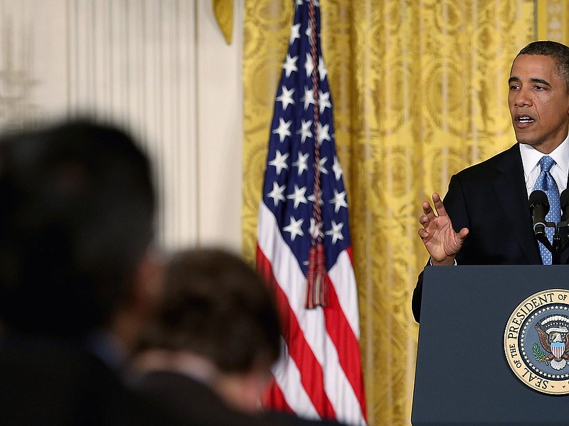 U.S. President Barack Obama speaks during a news conference in the East Room ...