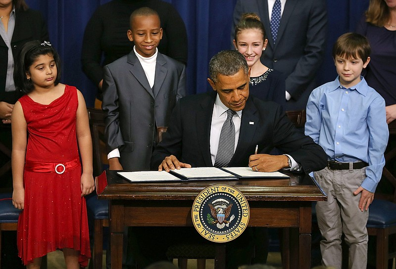 U.S. President Barack Obama signs a series of executive orders about the admi...