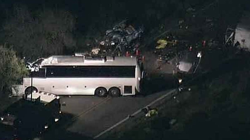 Eight people were killed and dozens injured after a tour bus crashed into a p...