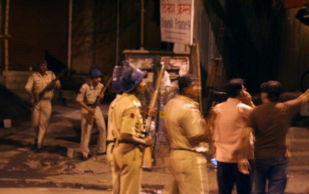 Police looking for attackers outside Colaba, Mumbai, India 2008.