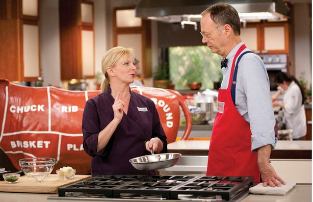 Chef Bridget Lancaster in the test kitchen with host Christopher Kimball.
