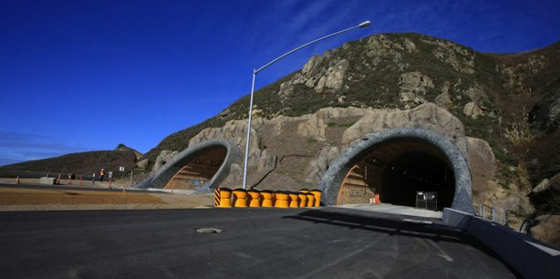Devil's Slide Tunnels Project is two tunnels beneath San Pedro Mountain, each 30-feet wide and 4,200-feet long. At the northern end, a 1,000-feet bridge will span the valley at Shamrock Ranch. A re-alignment of Route 1 at the southern end will provide safe transition into and out of the tunnel. Approximately one-quarter mile south of the tunnel is the site of an operations and maintenance facility. An earthen embankment and vegetation-covered roof helps the facility blend with natural surroundings.