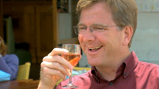 Rick enjoys a local rosé wine.