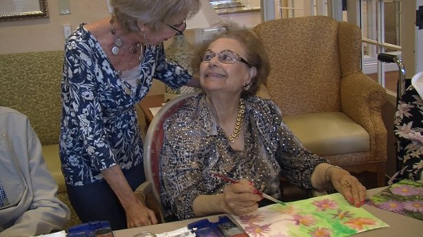 Art specialist Denise McMurtry with one of her Alzheimer's patients in the Memories in the Making art therapy classes.