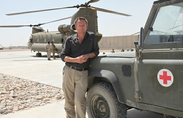Presenter Michael Mosley, in Camp Bastion, Afghanistan. The Medical Emergency Response Team (MERT) Chinook helicopter is in the background. Camp Bastion is the headquarters for coalition forces in Afghanistan.