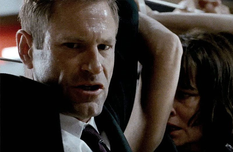 Aaron Eckhart plays a U.S. president who gets held hostage in