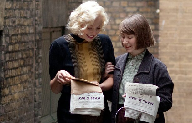 Helen George as Trixie Franklin and Bryony Hannah as Cynthia Miller in CALL THE MIDWIFE.