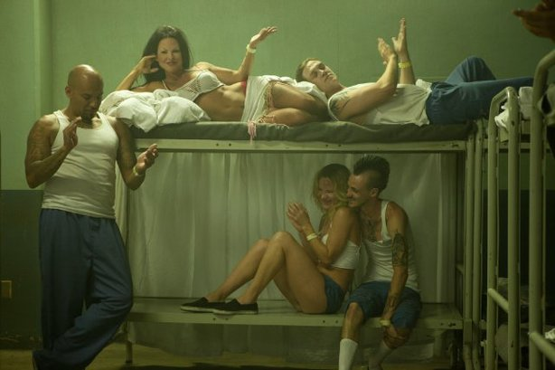 "Kate Del Castillo (center) camps it up as a transgender prisoner in ""K11."""