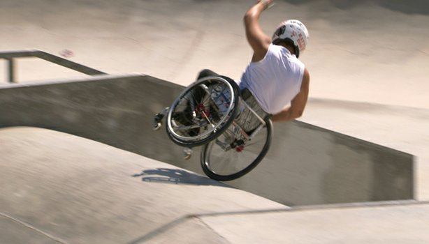 Aaron Fotheringham, a professional wheelchair motocross athlete living with s...