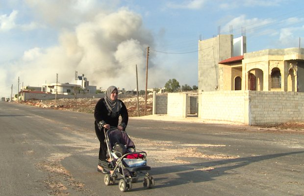 Moments after a deadly air strike hits the Sunni village of Al Barra, a Syria...
