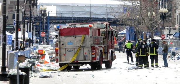 Firefighters take postion on Boyltson Street near the finish line after two bombs exploded during the 117th Boston Marathon on April 15, 2013 in Boston, Massachusetts.